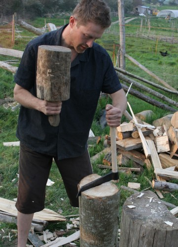 Splitting wood along the grain using a froe and mallet