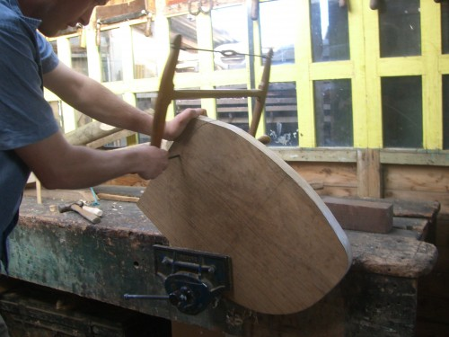 Cutting out a chair seat shape using a turning saw